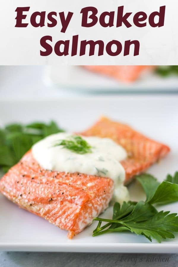 The finished easy baked salmon recipe on a plate with dill sauce.