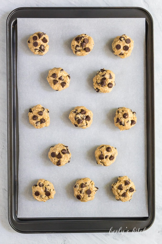 Dough has been formed into balls and placed on a cookie sheet.