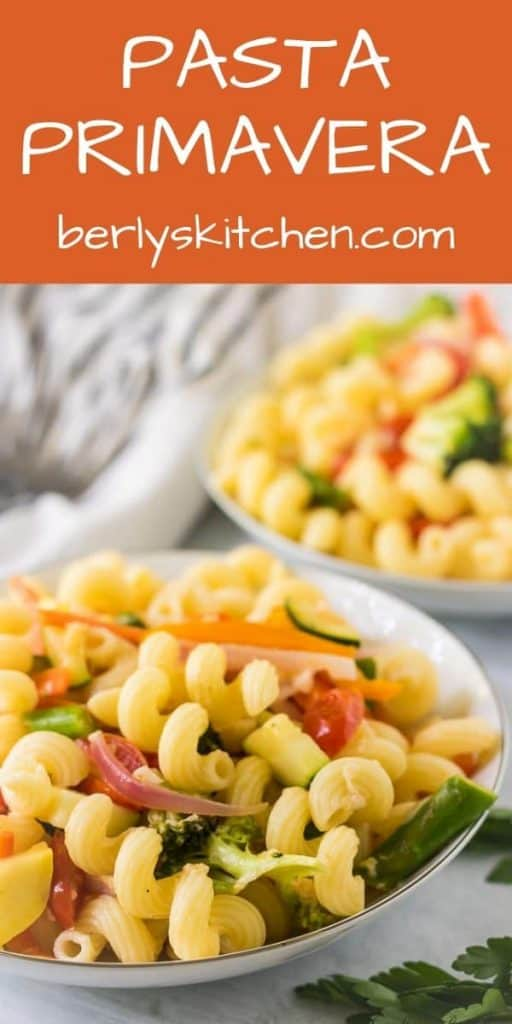 Two large pasta bowls filled with the easy pasta primavera.