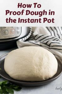 Plate of proofed pizza dough used for Pinterest.