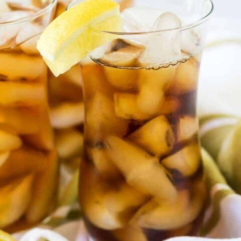 Glass of instant pot iced tea with lemon.