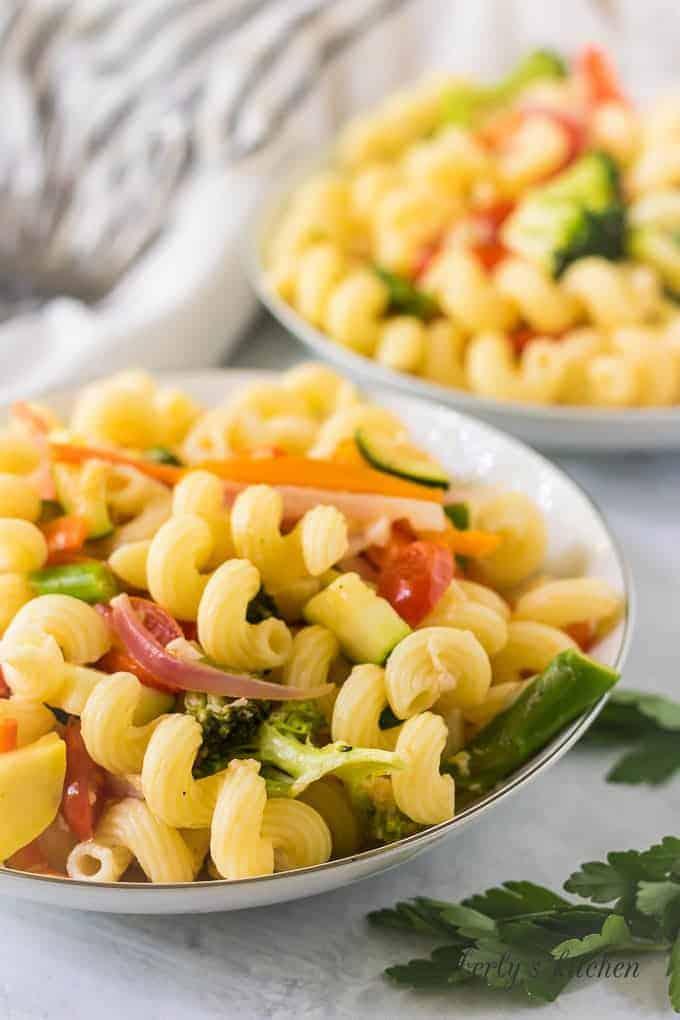 A close-up of the pasta primavera served in a pasta bowl.
