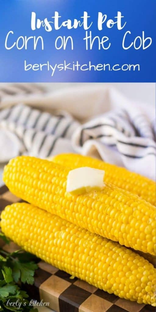 Four large ears of corn on the cob served with melted butter.