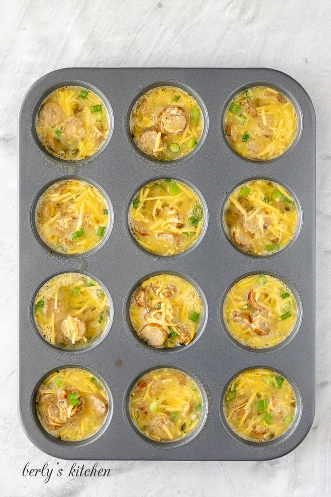 The egg mixture has been transferred to a muffin tin.