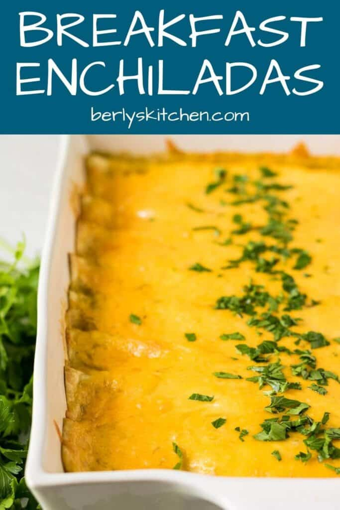 The finished cheesy breakfast enchiladas garnished with chopped fresh parsley.