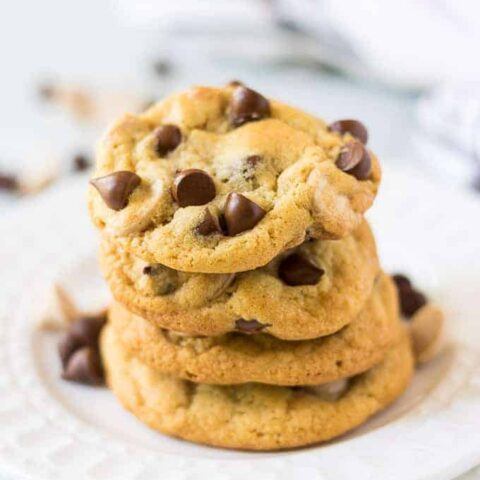 A stack of the caramel chocolate chip cookies on a plate.