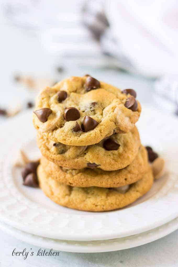A small stack of four caramel chocolate chip cookies.