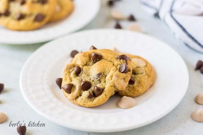 The chocolate caramel chip cookies on a white serving platter.