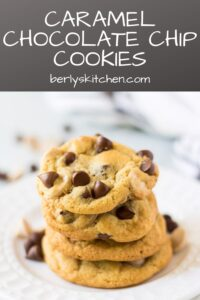 A stack of four caramel chocolate chip cookies on a plate.