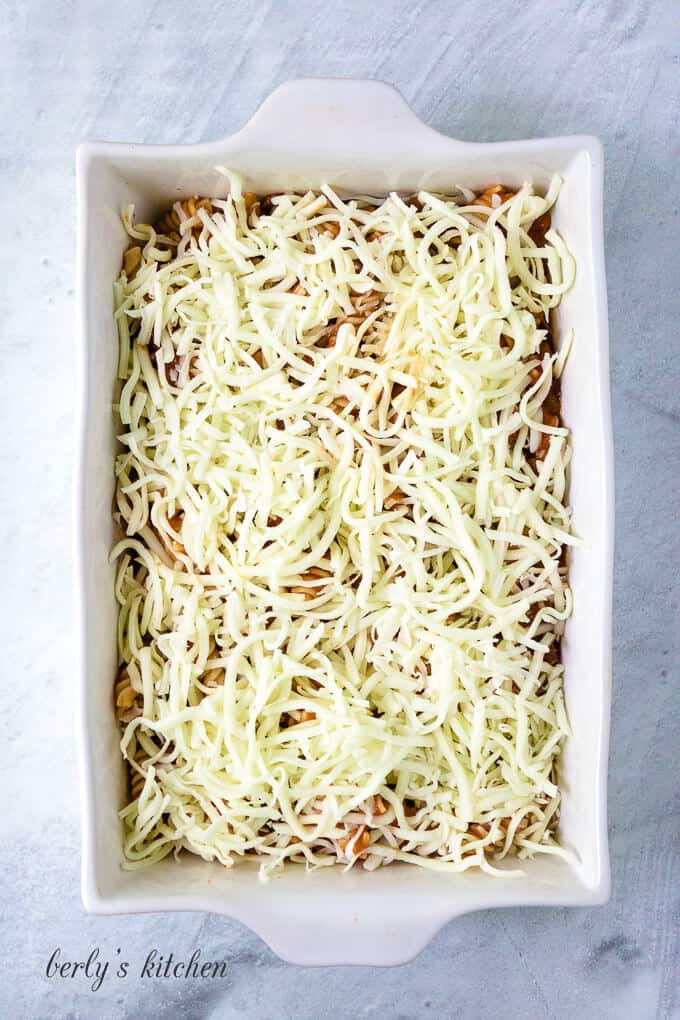 Everything has been transferred to a baking dish and covered with cheese.