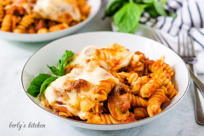 The finished cheesy pasta bake served in a white bowl.