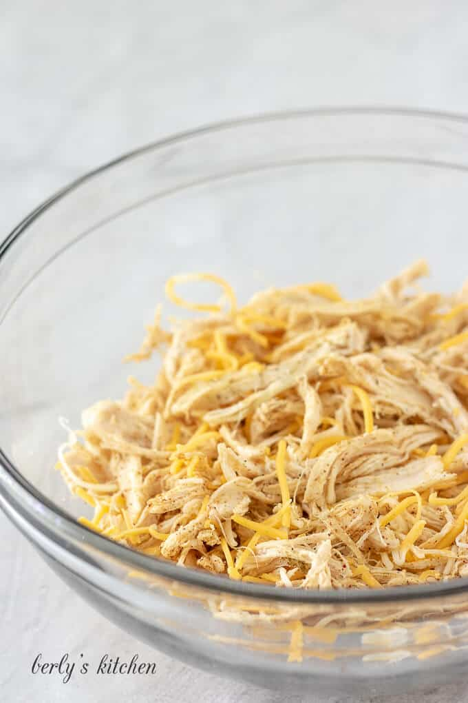 Shredded cheese has been combined with the meat and spices.