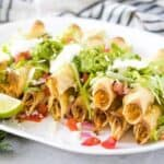 The baked chicken taquitos with lettuce, tomatoes, and sour cream.