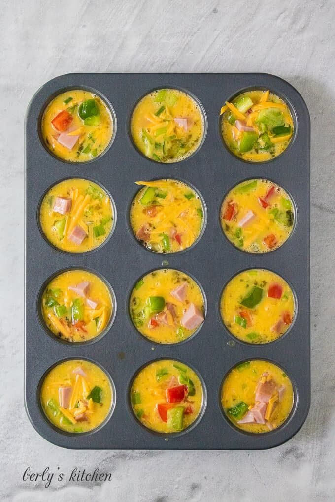 The Denver omelette ingredients have been transferred to a muffin tin.