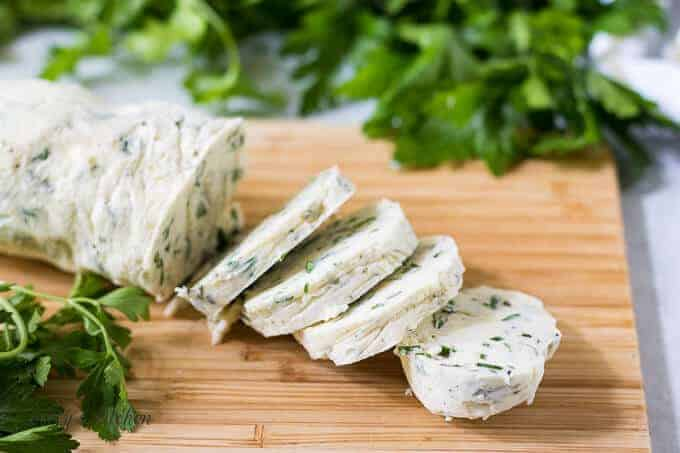 A log of the garlic herb butter sliced for use.