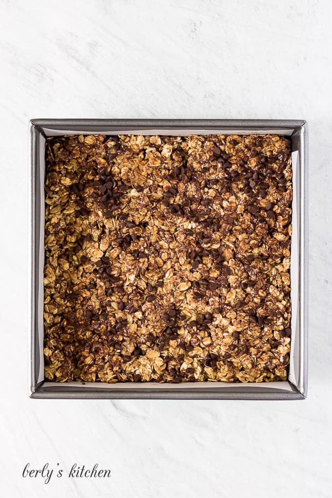 The granola mixture has been transferred to a pan for refrigeration.