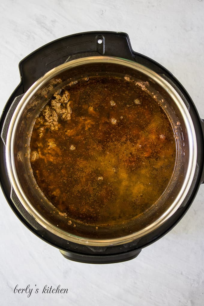 The beef broth has been added to deglaze the liner.