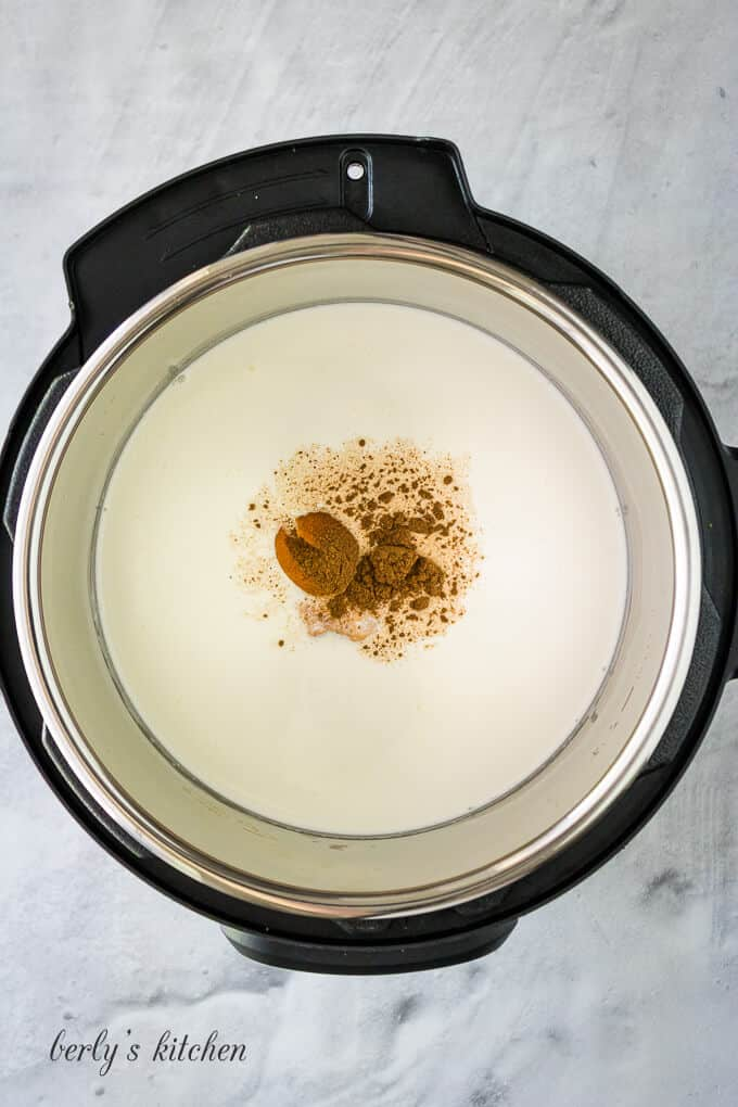 Milk, cream, and spices added to the pressure cooker liner.