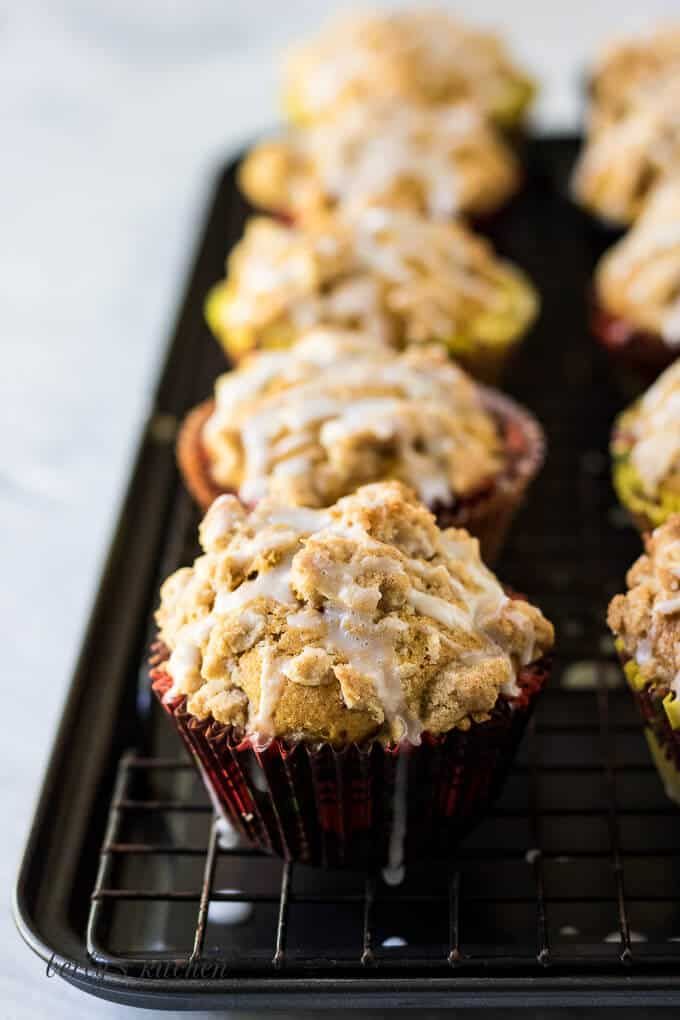 A close up of a muffin topped with streusel and glaze.