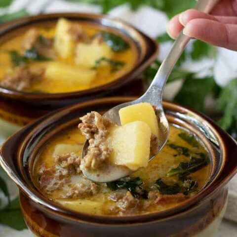 A big spoonful of the hearty sausage and potato soup.