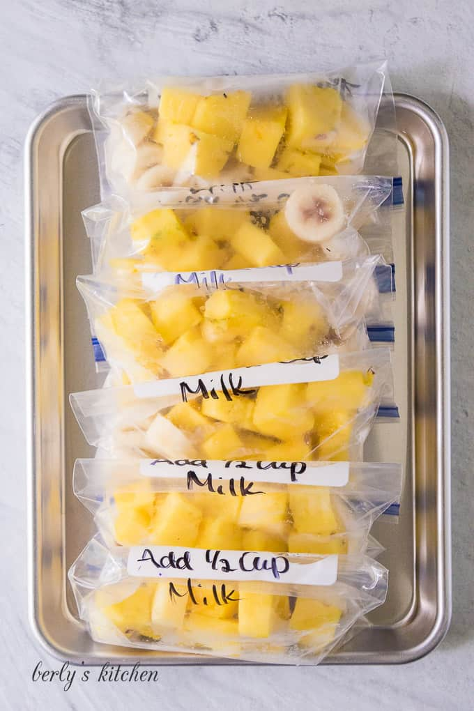 The fruit has been portioned out into small freezer bags.