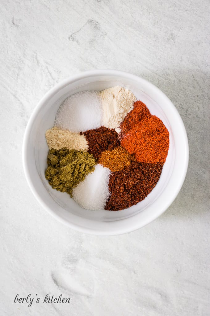 All of the different spices separated on a small plate.