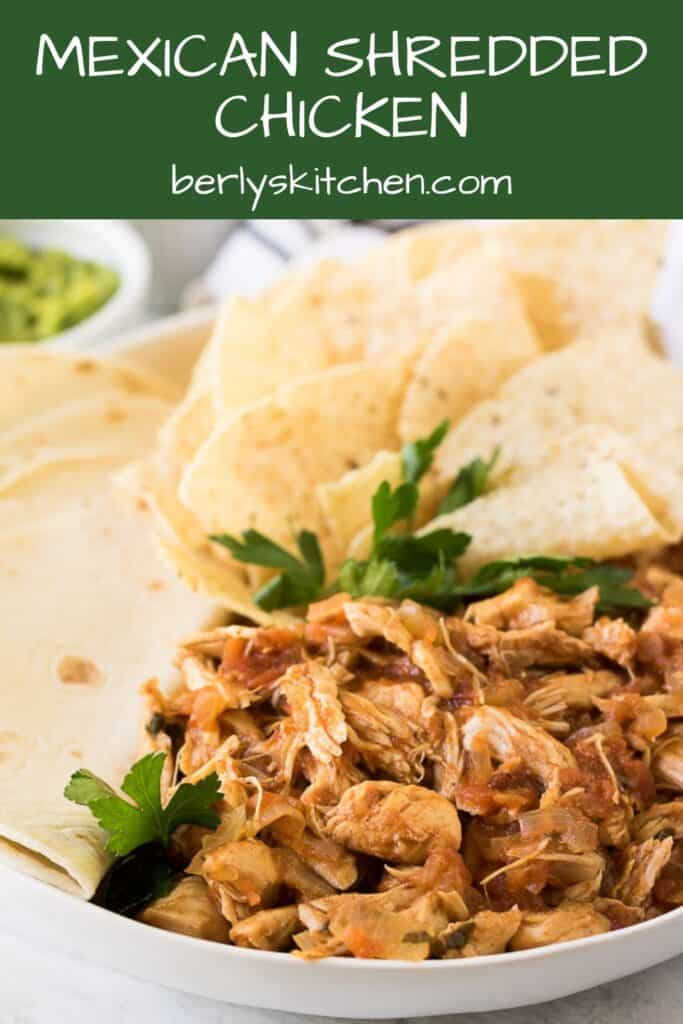 The pressure cooker Mexican chicken garnished with tortillas and cilantro.