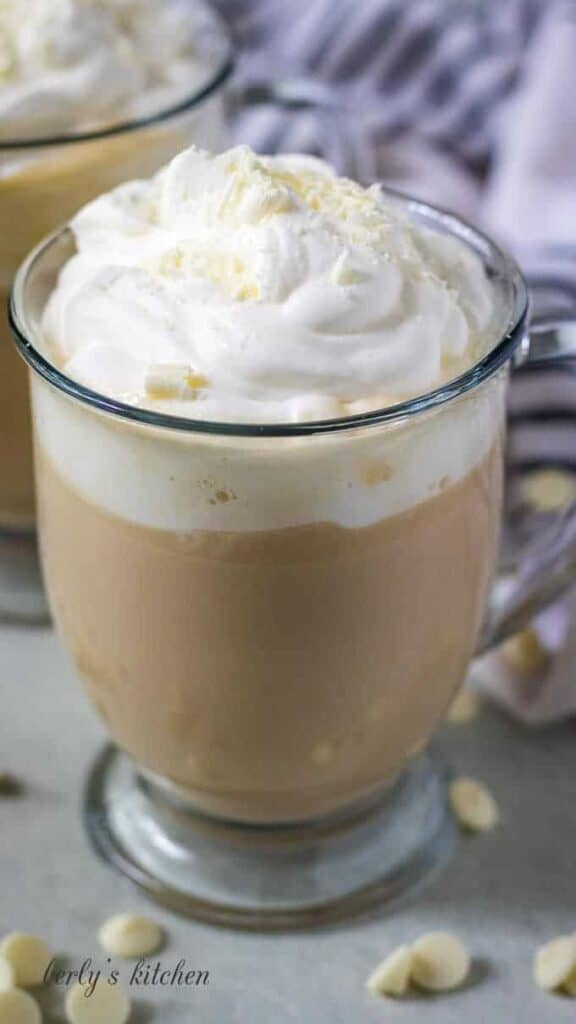 The finished coffee drink topped with fresh made whipped cream.