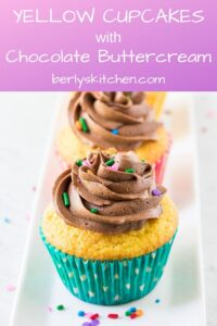 The cake mix cupcakes on a plate topped with frosting and sprinkles.