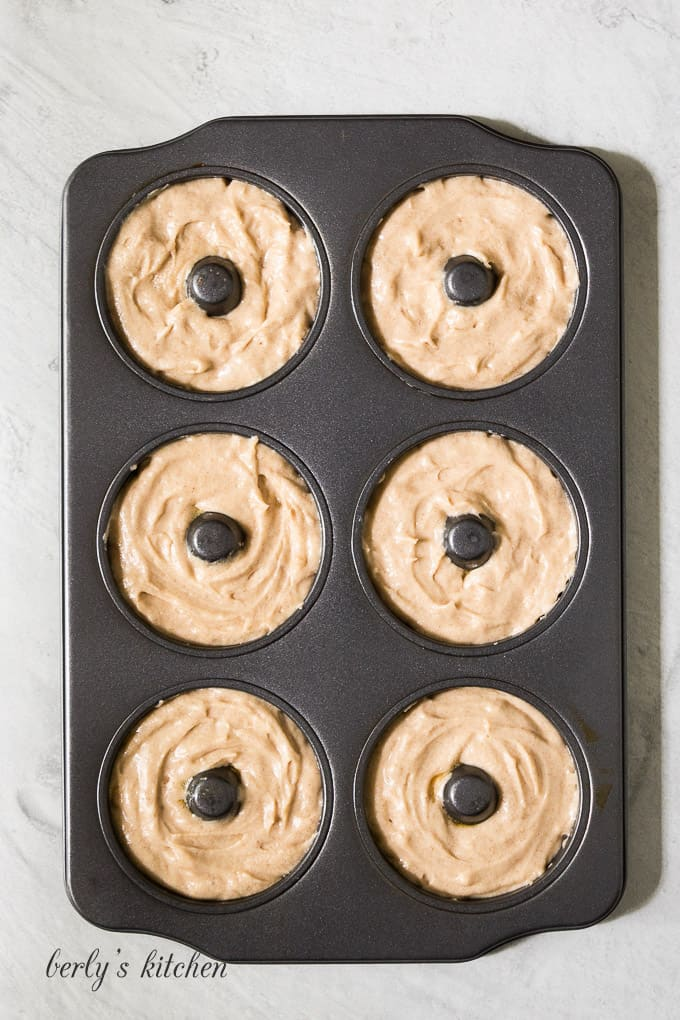 The batter has been transferred to a cake donut pan.