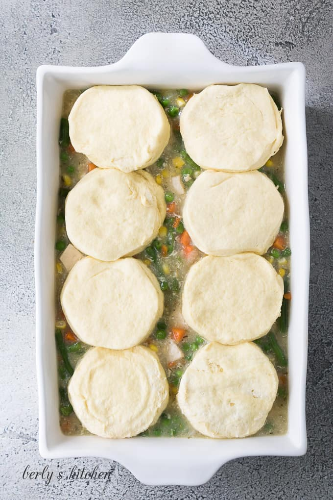 The filling transferred to a baking dish and topped with biscuits.