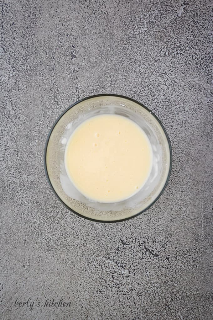 Powdered sugar and orange juice combine to make a glaze.