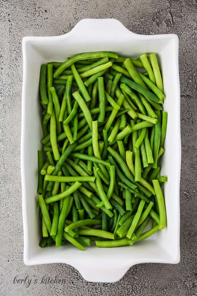 Washed and prepped green beans in a large baking dish.