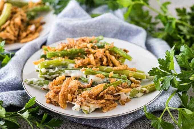 A serving of green bean casserole on a decorative plate.