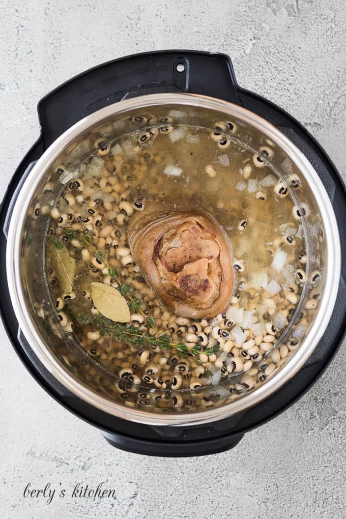 The broth, meat, and other ingredients added to the liner.