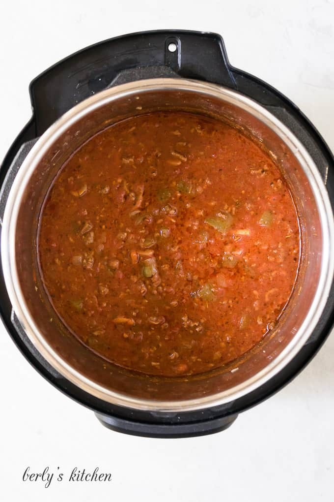 The sauce has finished cooking and is ready to serve.