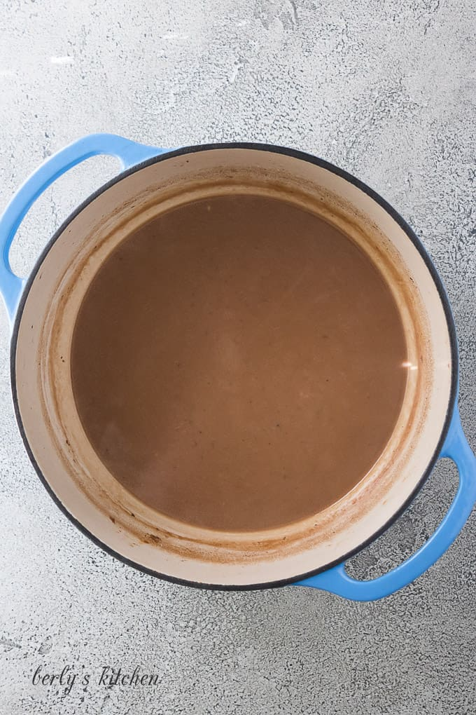 Gravy prepared with the pan drippings from the dutch oven,