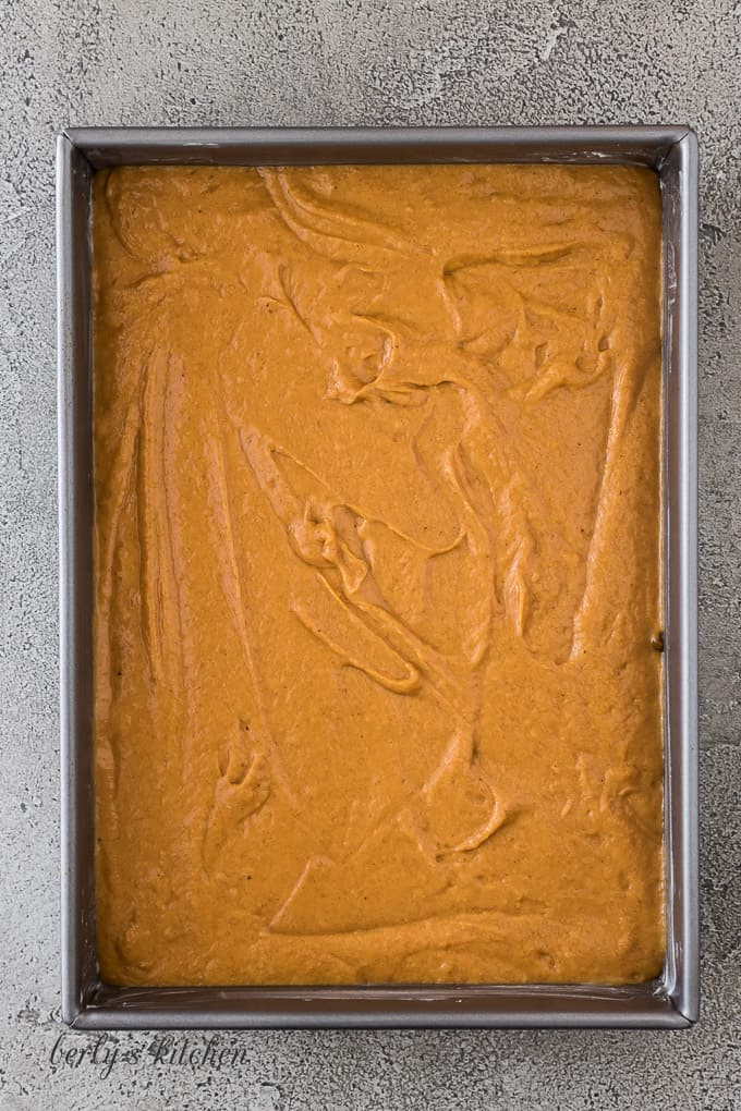 The pumpkin batter has been transferred to a cake pan.