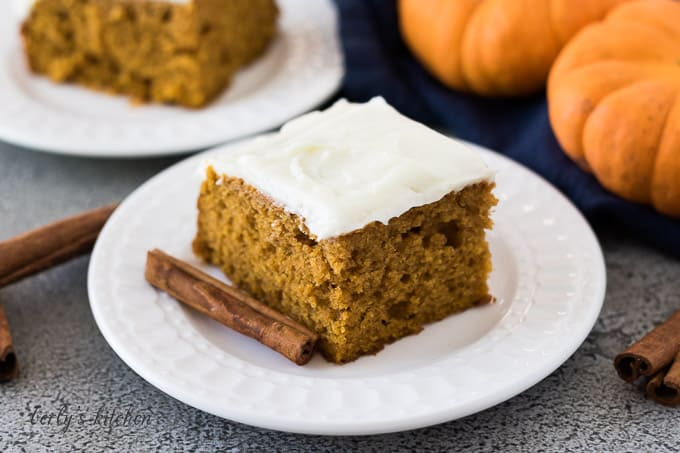 A slice of the pumpkin cake with a cinnamon stick.