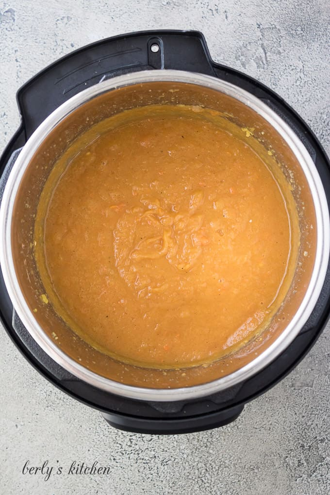 The soup has been blended and is ready for coconut milk.