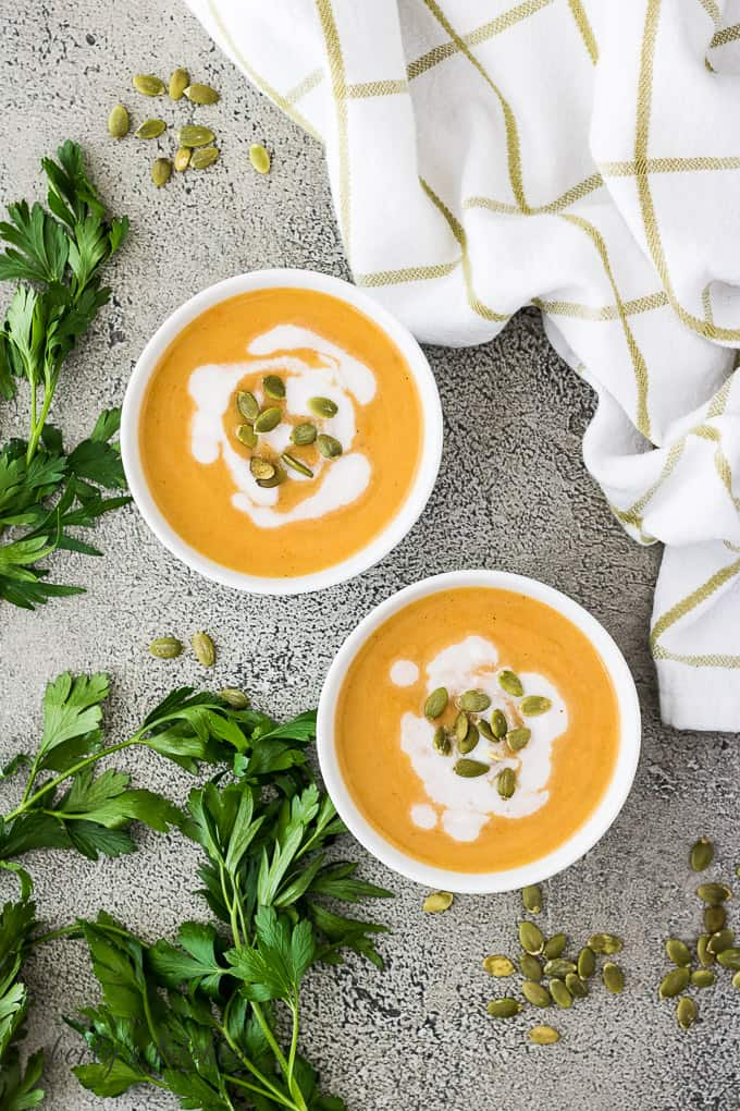 An aerial view of the finished soup with toasted seeds.