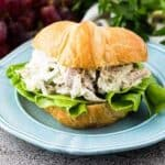The turkey salad served on a flaky croissant with lettuce.