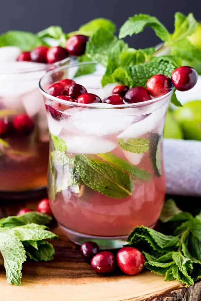 The finished mock cranberry cocktail garnished with fresh mint leaves.