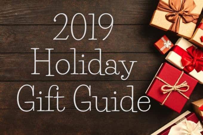 2019 Holiday Gift Guide next to Christmas gifts.