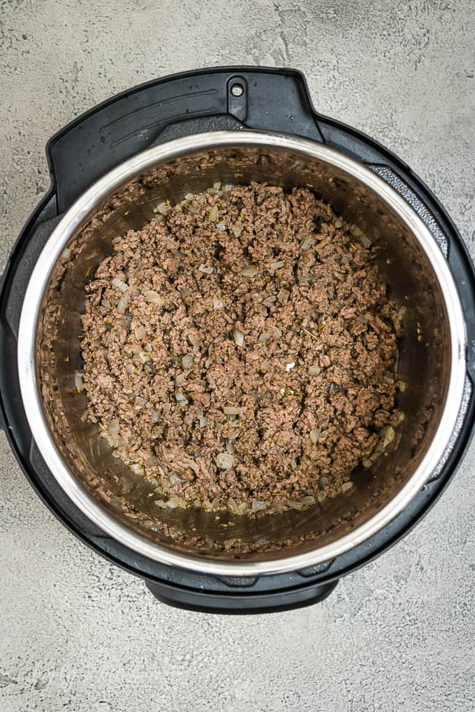 Ground beef and other ingredients sauteed in the pressure cooker.