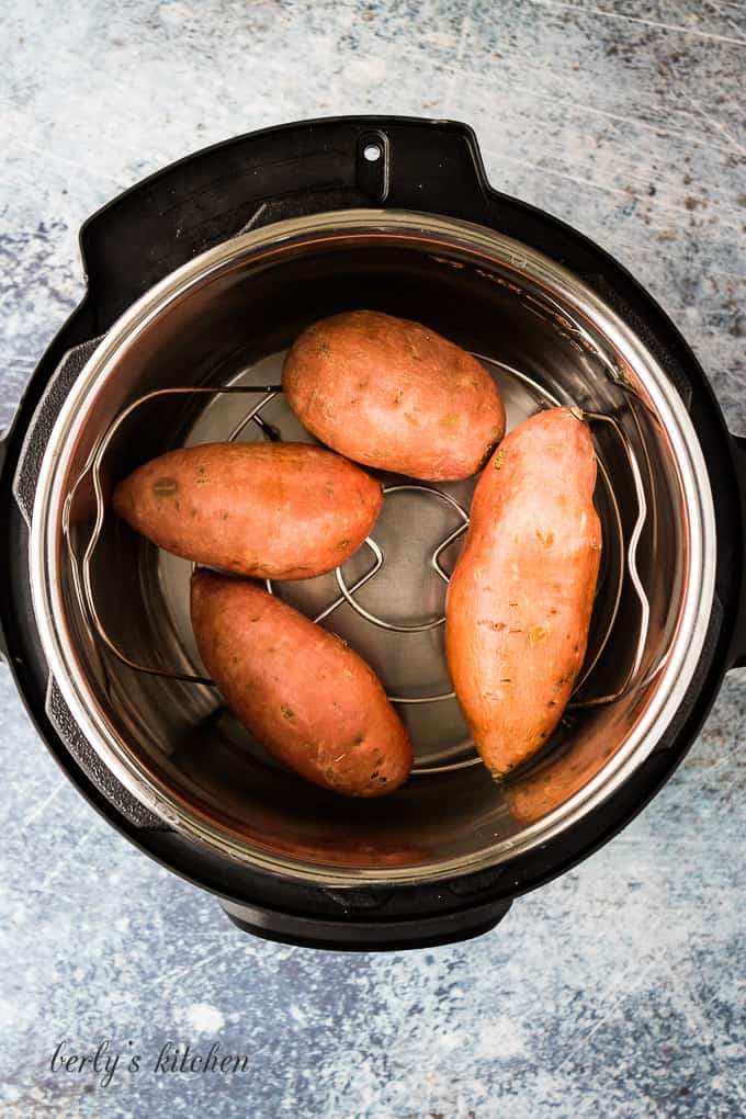 The prepped taters on a trivet in the pressure cooker.
