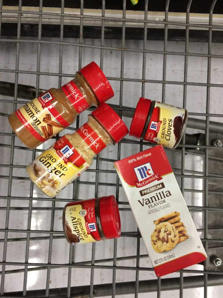 Ground spices, vanilla, and other products in a shopping cart.