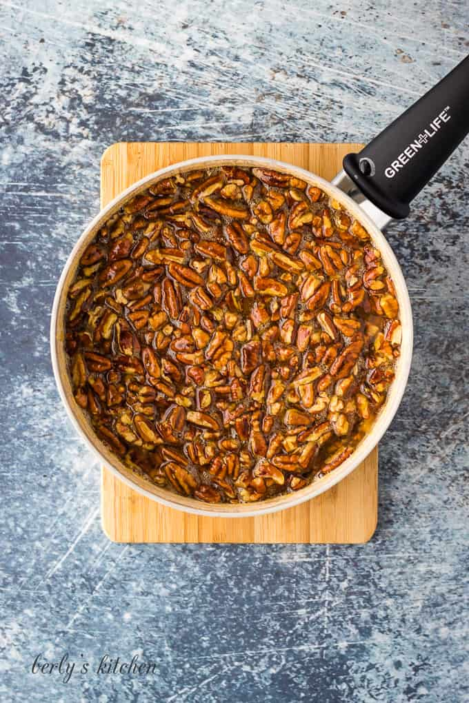 Pecan pieces have been added to the pie filling mixture.