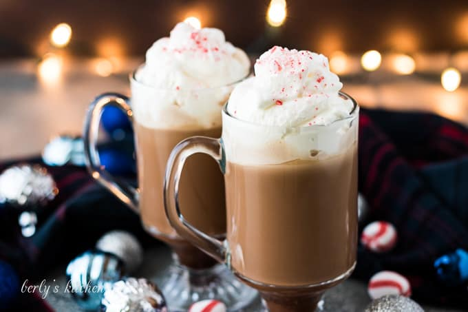 Two glasses of peppermint mocha topped with homemade whipped cream.