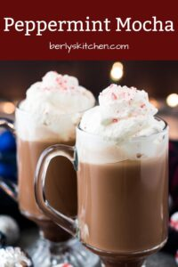 Two peppermint mocha coffees topped with whipped cream and ground peppermint.